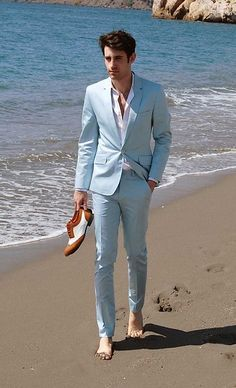 Slim fit suit in cool summery color. The suit without socks trend is taken a step further