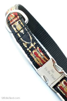 Fancy dog collar. Regal looking red, black and gold dog collar. Handsome for a male dog.
