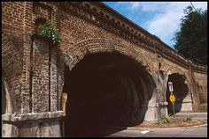 Just before a train would enter Savannah's Central of Georgia Railroad station, it would cross this 1852 viaduct (above), one of a pair of historic bridges at the former Central railroad complex. Spanning both West Boundary Street and the Ogeechee Canal, each of the two structures features four brick arches and decorative details in brick that create both elegance and utility.