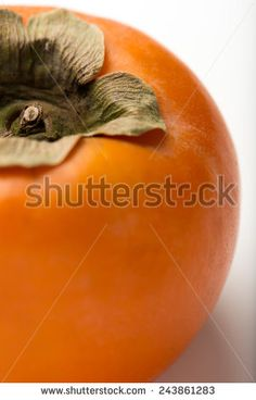 fresh, ripe persimmon, isolated on a white background, closeup, vertical - stock photo