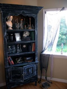 A potion cabinet. This is a great way to transform pre-existing furniture into Halloween decor. Casas Estilo Harry Potter, Witch Room, Goth Home, Gothic Home Decor, Victorian Gothic Decor, Gothic Room, Witch House, Witch Cottage, Gothic House
