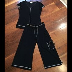 Coldwater Creek travel wear Cargo crop, top XS 4-6 I'm offering this darling CWC travel wear top & cargo wide leg crop Size XS or (4-6) This very slinky package rollable no wrinkle fabric is 95% Acetate & 5% Spandex. Black with white zig zag stitching trim. Drawstring ties are black with white pok a dots. Left leg has cute little pocket. Wonderful travel or lounge piece. New condition. Smoke free home  Coldwater Creek Other