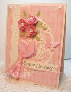I actually CASED a card I had made awhile back, you can see it HERE.   I really enjoy making these rolled flowers, but this card would not be an easily mailable card because those roses are very thick and stick off the card a bit.