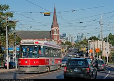 Rush hour in the city begins to wind down on this warm evening, meanwhile on Dundas St. West, a westbound CLRV trudges past fighting the constant barrage of cars.