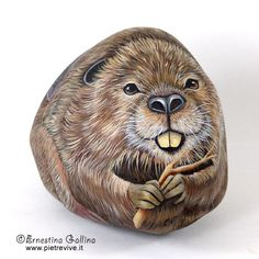 Hand painted rocks.Wildlife animals painted on stone. Beaver