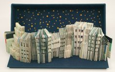 "Mary Howe, ""NYC,"" Stonington, Maine, 2011. A Manhattan visitor's guide is reassembled and carved to create an image of the New York City skyline. A magnetic clasp permits the bookwork to be worn as a bracelet."