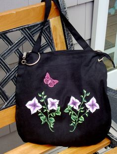Messenger Bag with Flowers and Butterfly Charm by It's In The Bag - $30.00 - Handmade Accessories, Crafts and Unique Gifts by It's In The Bag #thecraftstar #uniquegifts #giftsunder30