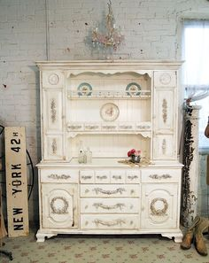 French-style china cabinet with rose appliqués and crystal knobs.