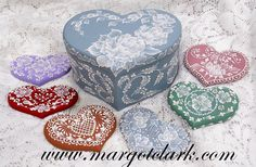 This tutorial - Heart Box and MUD Cookies will teach you how I create all these designs. The wood shapes and heart box are available on my website under Surfaces. Printed form  $18.95 http://www.margotclark.com