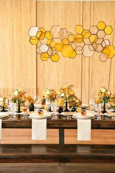 Saucy & Kitsch handmade this honeycomb-inspired hexagon chandelier from cardboard, parchment, and crepe paper