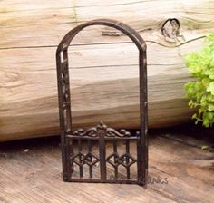 """Add whimsy to any miniature garden with this 4x8"""" arbor with gate."""