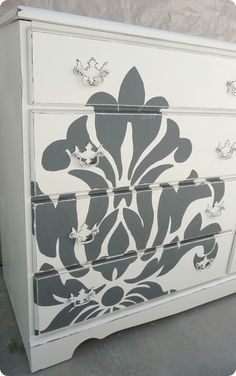 Damask pattern painted on dresser - I especially like how its enlarged and off center.  Cool.