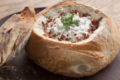 Fill a bread bowl with bacon-studded stuffed mushroom dip and enjoy the appetizer portion of this evening's entertainment.