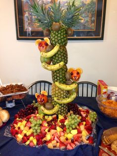 My husband's super cute Pineapple tree! Baby shower idea. Jungle theme. Party. Centerpiece. Fruit. Healthy party food.