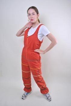 Ellesse orange suspenders ski suit, woman snow jumpsuit, Size M Welcome to TARASCOMMON. Model tall - Size: M. Ellesse, Vintage Ski, Vintage Ladies, Orange, Winter Suit, Snow Pants, Snow Suit, Unique Outfits, Suspenders
