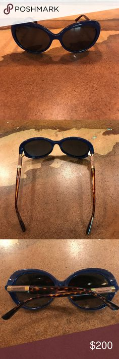 Blue Tory Burch sunglasses⚜️ Excellent condition.  Navy blue with gold,wood, tortoise detail.  I love these because they are not so dark👍. No case.  As is, and that is a good deal🖤 Tory Burch Accessories Sunglasses