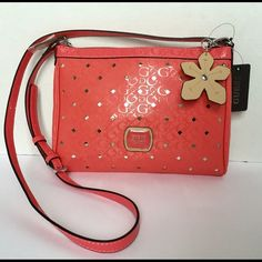 """SALE‼️GUESS PRESTON PINK CROSSBODY PURSE  *NEW* GUESS PRESTON CROSSBODY HANDBAG  STYLE:  SV626314  COLOR: PASSION (CORAL,PINK,SALMON)  ~NEW WITH TAG~  GUESS Super Stylish Metallic Cut-out Silver Details  LOGO Hardware in the Front   One Large Internal Open Compartment with Top Zipper Closure  Inside there's Open Slip Pockets & Zip Pocket  Leopard Print Lining   MEASUREMENTS 10.75 X 8 X 2  Strap Drop 22"""" 🚫NO TRADES!🚫 Guess Bags Crossbody Bags"""