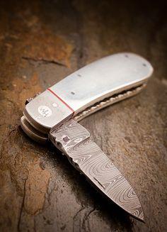 The Wyatt, craftsman-made silver pocket knife available on bourbonandboots.com