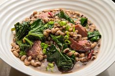 NYT Cooking: Black-Eyed Peas With Ham Hock and Collards. We enjoyed this and put it in the family book of recipes. Pea Recipes, Cooking Recipes, Cooking App, Cooking Videos, Vegetable Recipes, Healthy Recipes, Salt Pork, Ham Hock, Collard Greens