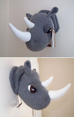 Based on a pattern by www.Pepika.com -   A hand crocheted faux taxidermy Rhino head to hang on the wall.  Hes definitely a friendly rhino, so