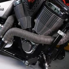 DEI now offers an exhaust wrap that is specifically designed to hold up against the rigors of off-road and extreme-duty use. The EXO Series™ exhaust wrap is a dual-layer design, using a combination of hi-temp fiberglass, covered with a 304 grade stainless steel exoskeleton. This unique construction maintains good heat protection while offering superior abrasion and impact protection. Despite its burly appearance, the EXO Series™ exhaust wrap weighs nearly the same as normal exhaust wrap. Motorcycle Exhaust, Layers Design, Hold Ups, Exhausted, Exo, Engineering, Construction, Stainless Steel, Unique