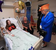 The Queen speaks to Millie Robson, 15, and her mother Marie, from Co Durham, during a visi...