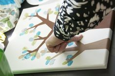 Finger print tree - cute idea for a baby shower, or even as guests come by to visit a new baby...