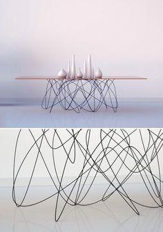 Subatomic Table by Jason Phillips: http://jasonphillipsdesign.prosite.com/995/128517/gallery/quantum-table