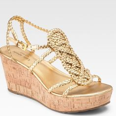 Gold Kate Spade wedge sandals Super cute, barely worn (2 or 3 times) gold braided rope cork wedge sandals. Can wear them with jeans or dress them up. The wedge is about 2 inches. Officially called 'Kate spade beachy metallic leather wedge sandals'. Let me know if you'd like additional photos or have any questions! kate spade Shoes Wedges