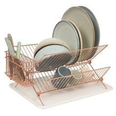 No one likes to do dishes, but just about everyone can get behind good design. This copper-plated dish rack by Present Time is shiny, classic and plenty functional. When a recipe calls for more counter space, just fold up the rack and tuck it away. Kitchen Rack, Kitchen Dishes, Kitchen Items, Kitchen Dining, Kitchen Board, Dining Decor, Kitchen Supplies, Kitchen Tools, Kitchen Decor