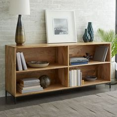 Crafted from solid mango wood and lofted on airy steel legs, our Rustic Storage Modular Bookcase includes compartments for displaying and organizing books, magazines and other knick-knacks.