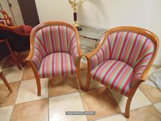 Lot 1191 - A pair of polished mahogany framed upholstered club chairs multistripe satin type fabric