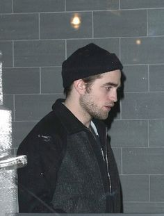 Robsten Dreams: Rob Pic of the Day ~ Enjoying a night out with his girl. -- leaving restaurant in NYC, Nov 2009