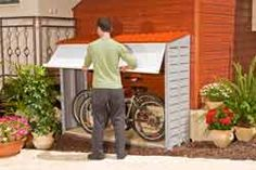build along the entire side of the house for bike and trash can storage - protected from the elements