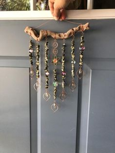 This fairy forest sun catcher features highlights of shiny copper wire, faceted . This fairy fores Driftwood Projects, Driftwood Art, Carillons Diy, Diy Wind Chimes, Deco Originale, Beaded Curtains, Handmade Copper, Handmade Art, Handmade Beads