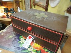 Vintage treasure box with bakelite handles. From Vendor 248 in booth 96. Priced at $25.00. ~ The Brass Armadillo Antique Mall in Denver, CO. 303-403-1677 ~