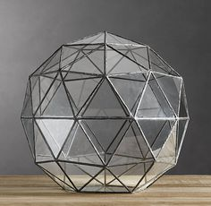 Geodesic Terrarium\\As I have mentioned here before, I puffy-pink-heart terrariums. I should just start a terrarium board, which would be the nerdiest board in the history of Pinterest.
