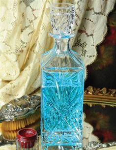 "MOUTHWASH DECANTER  Dazzling cut glass will replace the unsightly medicinal, plastic bottle with a clever cup/lid.  Holds 25oz 11"" H"