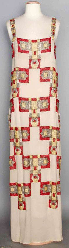 """VIONNET BEADED EVENING DRESS, c. 1922 Tabby woven cream silk w/ geometric checkerboard pattern in gold, silver & red glass beads, long tubular dress, 1.25"""" beaded shoulder straps, unlined, early label of white silk w/ tambour embroidered """"Madeleine Vionnet"""" & original inked thumbprint, B 34"""", H 38"""", L 60"""", (unhemmed, silk dirty, bead losses especially on shoulder straps, inner silk taffeta waistband shattered, snaps on facing at neckline possibly for missing slip, 1 tiny hole) very good."""