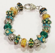 This one of a kind, Pandora compatible Murano glass bead hand-made bracelet…