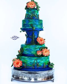 Water lily wedding cake inspired by Monet's Water Lilies paintings. Hand made and painted flowers, corset piece, and fondant covered tiers.