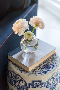 Beautiful blush ranunculus atop a classic blue and white Chinoiserie-inspired garden stool.