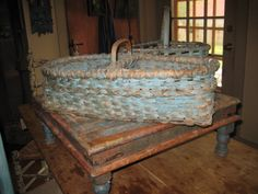 Prim...old blue cheese board...with two weathered & worn blue baskets...
