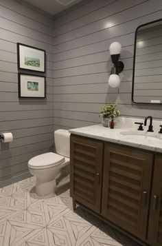 Want to upgrade your powder room to something more modern? I redesigned a very cramped and outdated bathroom to make it more spacious and modern. I added geometric tile and grey wood panel walls, and it turned out great! Check out the entire powder room transformation