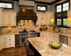 cream cabinets…granite is similar to what ours will be