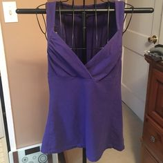 Express stretch tank top Used condition, still in good shape though. Slightly faded. This shirt shows lots of cleavage! Express Tops Tank Tops