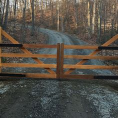 Tri State Gate installed this rustic cedar entry gate on a ranch property in New York. Although the design is farm/ranch style, this driveway gate is automated and features a secure keypad entry since we couldn't install automatic sensors due to the seasonal ground freeze. Designed and installed by Tri State Gate in Bedford Hills, New York.