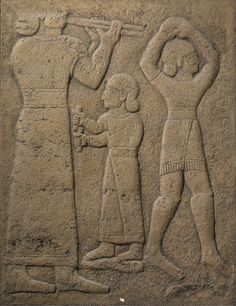 Plaster cast of a Neo-Hittite relief; large figure on left, walking right, wearing a long gown and playing double pipes; small central figure with pair of rattles; figure on fight wearing a short skirt or kilt and dancing with both hands clasped overhead; painted brown in imitation of original limestone; mounted in wooden frame; hairline crack in centre. Culture/period:      Neo-Hittite - 10thC BC