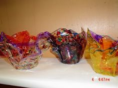 """coloring overhead transparencies with permanent markers, placing the transparencies on clay pots and heating with the heat gun to create """"glass Macchia"""""""