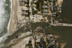 MANTOLOKING, NJ - OCTOBER 31: Homes sit in ruin at the end of a bridge wrecked by flooding from Superstorm Sandy on October 31, 2012 in Mantoloking, New Jersey. At least 50 people were reportedly killed in the U.S. by Sandy with New Jersey suffering massive damage and power outages. Photo: Mario Tama, Getty Images / 2012 Getty Images